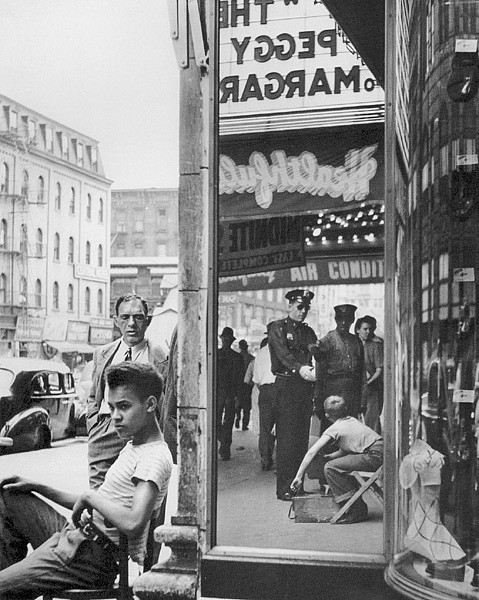 Morris Engel ,   Shoeshine Boy with Cop, 14th Street, New York City  ,  1947     photograph ,  14 x 11 in. (35.6 x 27.9 cm)     ME903
